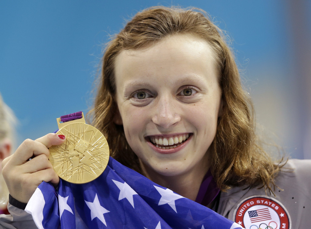 United States' Katie Ledecky holds up her gold medal after winning the women's 800-meter freestyle swimming final at the Aquatics Centre in the Olympic Park during the 2012 Summer Olympics in London, Friday, Aug. 3, 2012. (AP Photo/Lee Jin-man)
