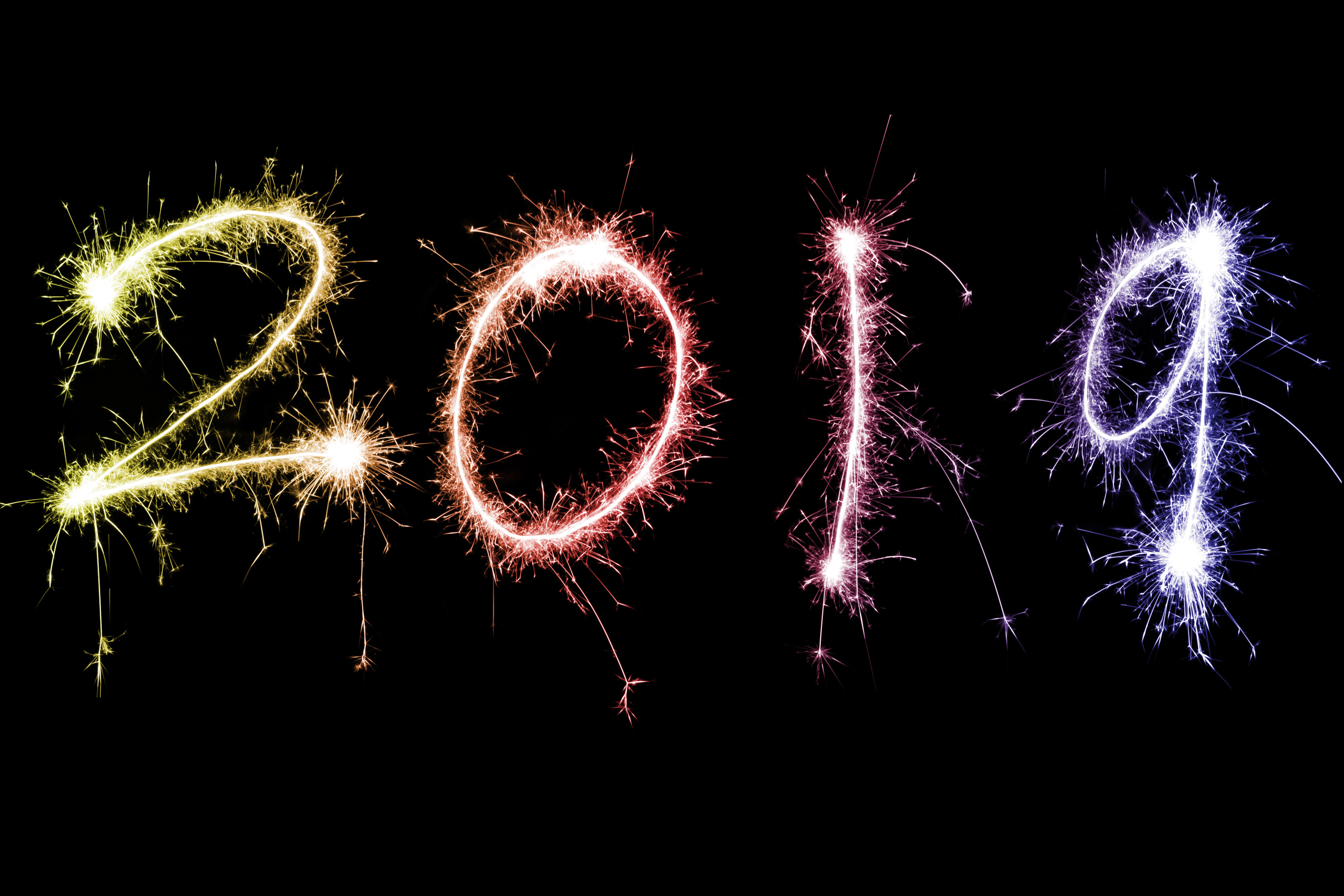 2019 year numbers in sparkling fireworks lights over dark background
